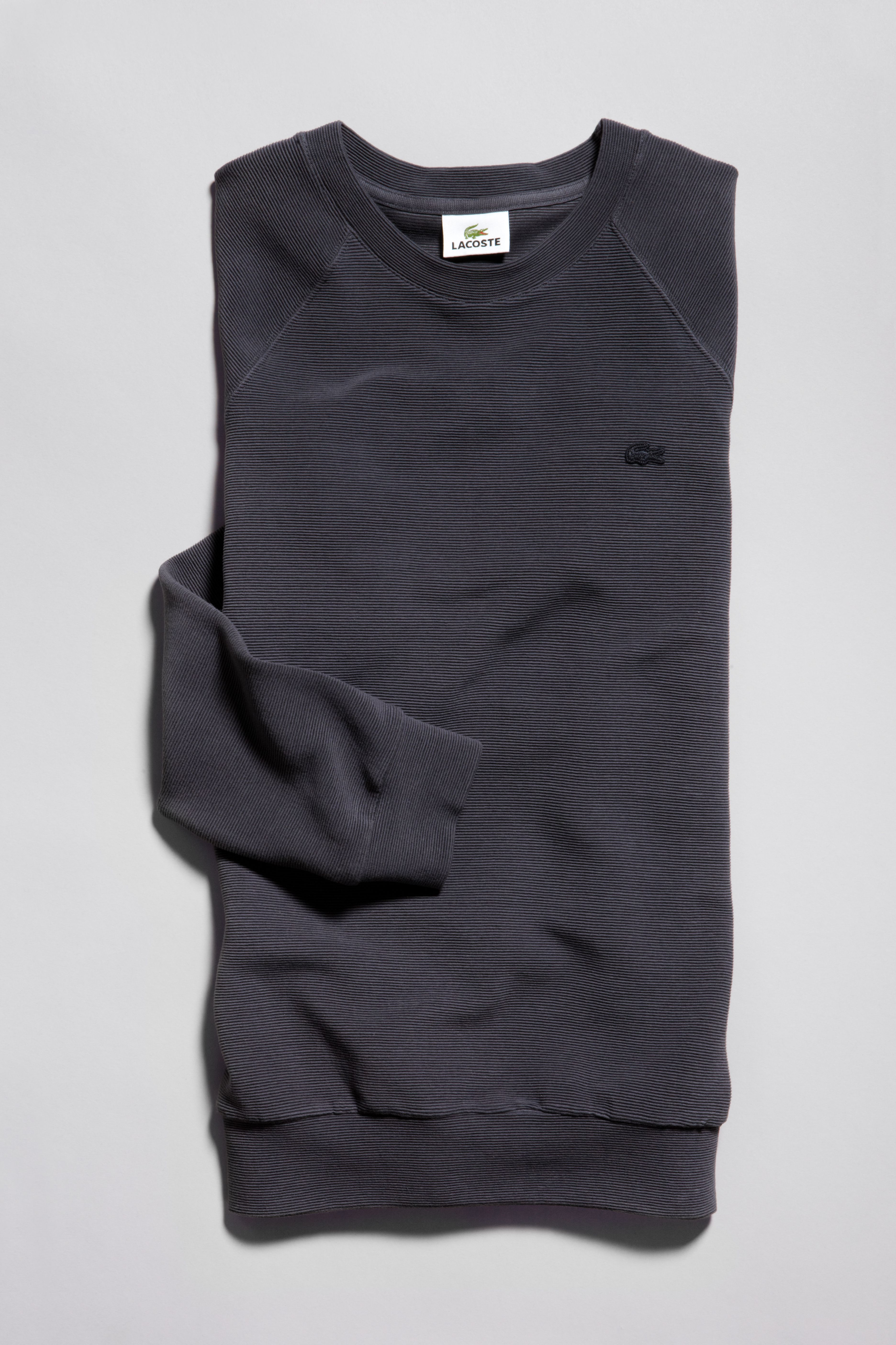 0164c6e357 Let the adventure begin with a black sweater from the Lacoste ...