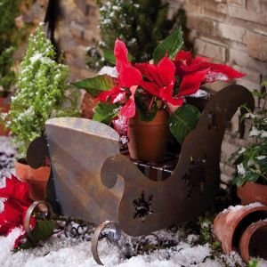 Sleigh features a rustic brown coloring  with snowflake accent desi...