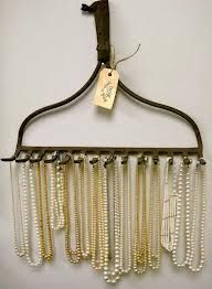 An old rake for jewelry storage.
