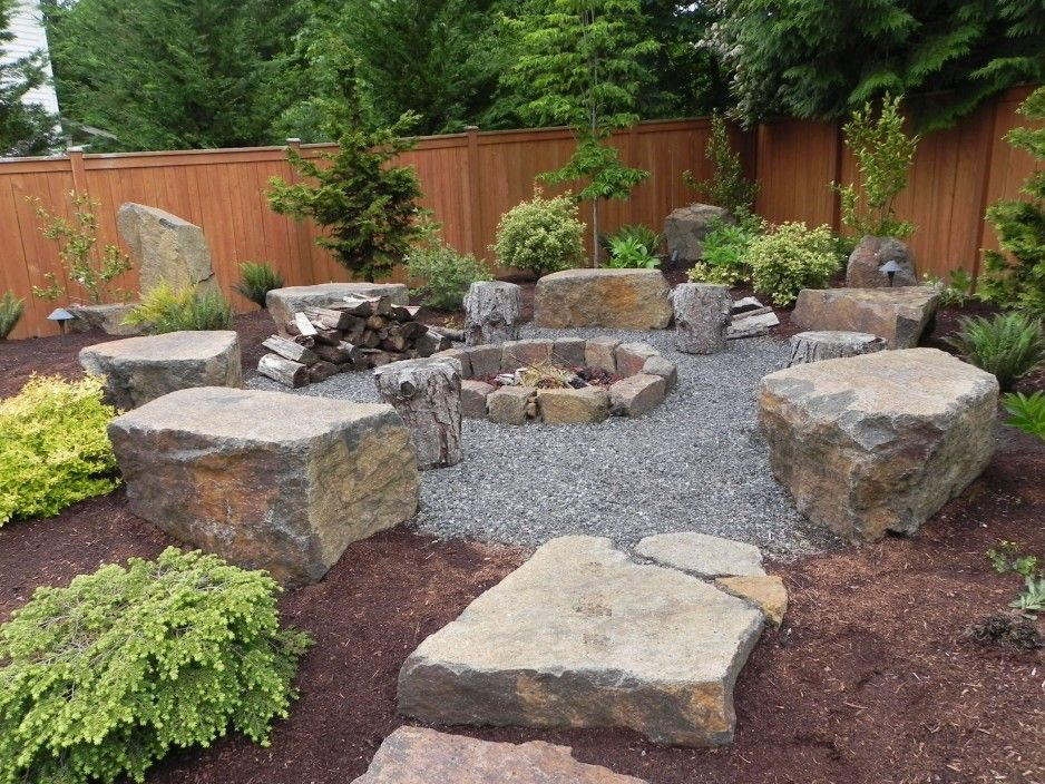 Like How The Fire Pit Area Is Framed In With Large Boulders And
