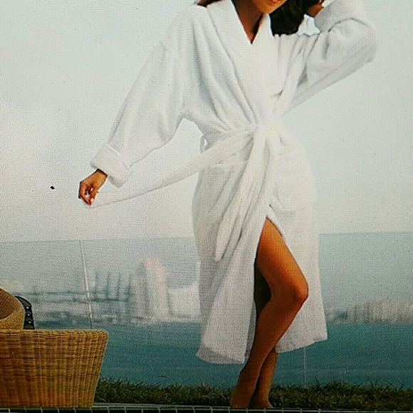 """SALELuxurious """"Inn"""" Spa Robe Gorgeous Spa Robe so luxurious in white.  Outer shell is of Microfiber twill while the full inside lining is of a fine weave Terrycloth.  Comes with self tie sash. Two large patch pockets. Left pocket has embroidered name of the Inn where I purchased it  Harbor Light Inn"""" .it's an Inn in Marblehead Mass. Used a few times. Slight hardly noticeable sign of wear is some yellow discoloration in neck area.  It has been laundered. otherwise in excellent condition. Like…"""