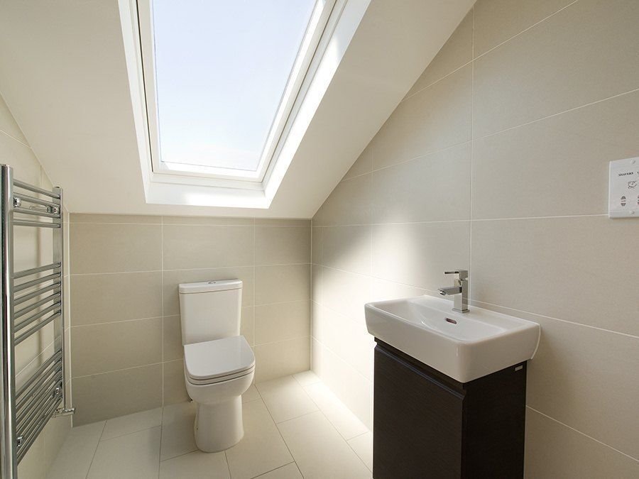 loft conversion bathroom ideas walls and floor in same tile 600x300 pale grey sand 20402