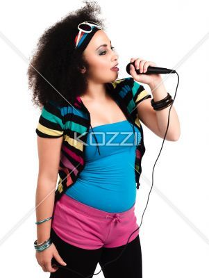 image of a young female singer. - Image of a young female singer with microphone against white background. Model: Taylor Chmiel