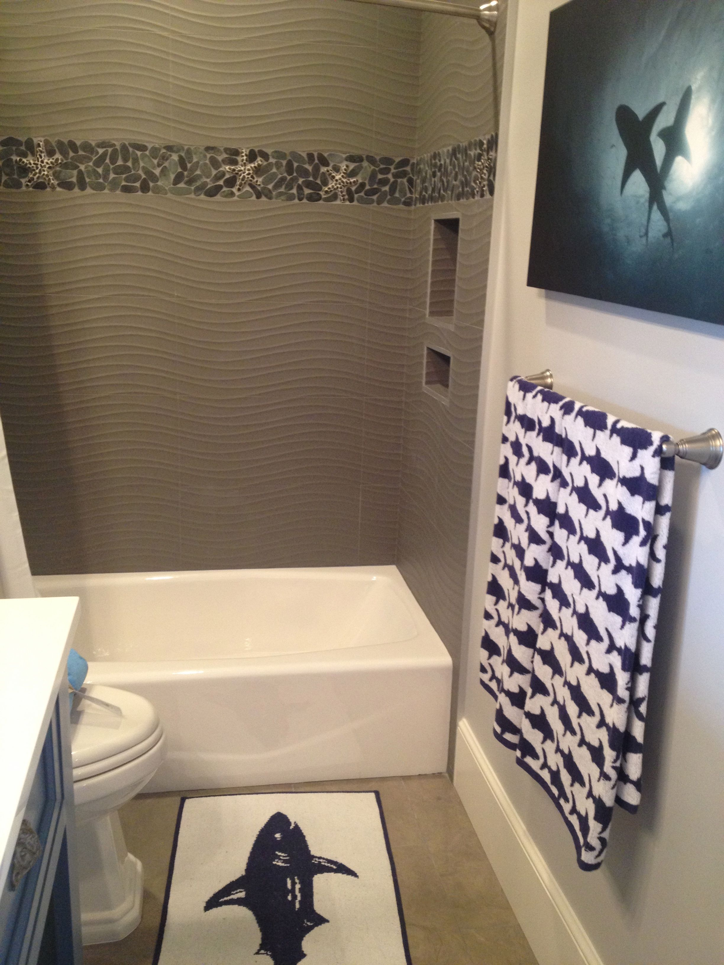 love the beach shower tile! cool shark themed bathroom off the