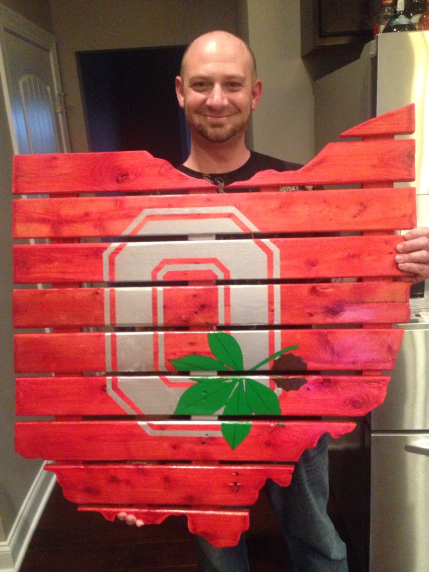 Here is my sister and her husband's wedding gift. Made it out of a pallet. Got an engineer print from Staples of the state outline and logo, Cut out the shape, dyed the wood with rub alcohol and food coloring, and painted the logo on. Clear coat over it all. Turned out great! Go Buckeyes!!