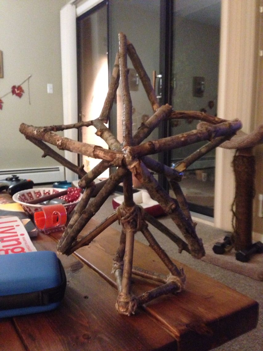 Made a Christmas Tree Star out of branches from the woods. Pretty easy- all you need is sticks, scissors, hot glue, twine, and a sheet of wax paper. Cut 10 pieces of sticks to the same length, then glue the tips together to make the outline of a star. Cut 5 smaller sticks and glue from the inner points of the star to the middle. Cut 5 long sticks and glue from the outer points of the star to the raised center created by the inner 5 sticks. Make a stand and glue/twine star to it. Ta-da!