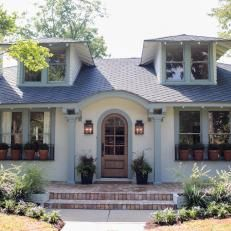Exterior: Renovated Bungalow With Arched Front Door