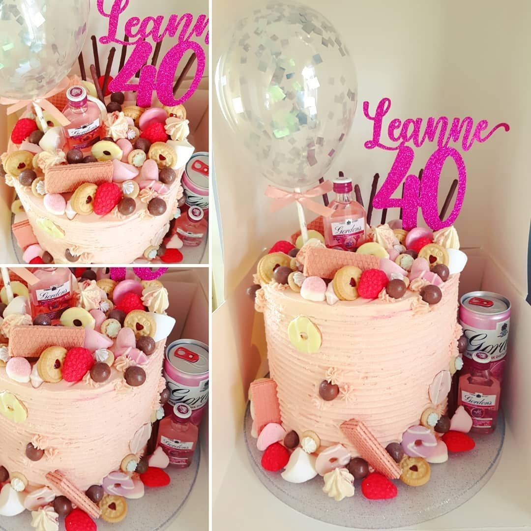 Happiest 40 th birthday wishes to our niece Leanne. All the good things on this cake including pink gin, mini meringues, marshmallows, pink panthers, party rings and Jamie dodgers ! Sponge is 6 layers of freeze dried strawberry and vanilla, filled with loads of strawberry conserve and vanilla butter cream.  Topper and cake balloon by the ever talented @burntisland_o #freezedriedstrawberries Happiest 40 th birthday wishes to our niece Leanne. All the good things on this cake including pink gin, m #freezedriedstrawberries