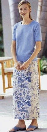 Modest Jocquard pencil skirt with matching powder blue top.  Model seems as modest as she looks.  Talbots c. 1996