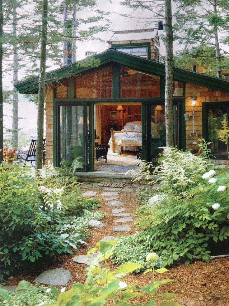 A Bed In A Room With A View That S All Please Cottage Exterior Cottage House Exterior House In The Woods