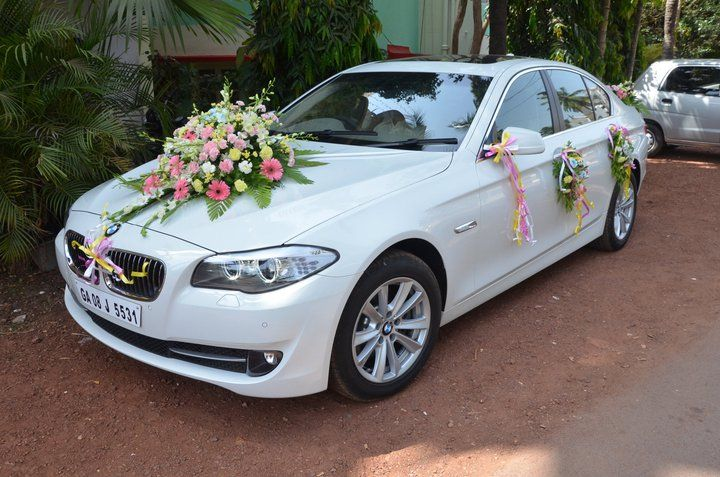 A White Bmw 5 Series Florally Decorated And All Ready For The Bride Wedding Car Decorations Wedding Car Wedding Car Deco