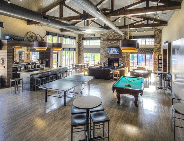 Open space with pool table, seating and bar area