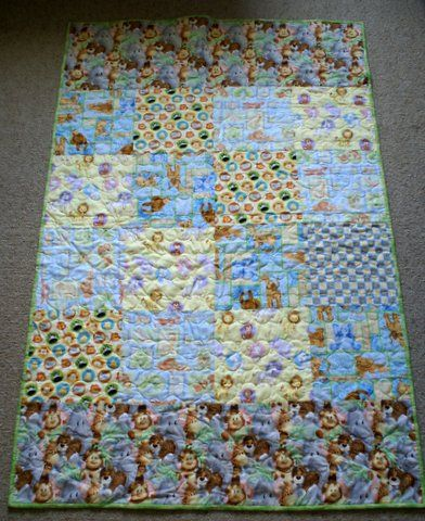 Australian Handmade Gifts - Animals Cot Quilt - $75 - https://www.highlandshandmade.com.au/animals-cot-quilt-75/ - Animals  Lions, tigers and more.  100% cotton front and backing fabric with lightweight wadding.  Machine quilted with heart shapes. Washable with a gentle cycle.  Suitable for little girls and boys. Size 137 x 82 cms  Made in the Southern Highlands of country NSW by Dennis Buck.  Time taken to make this was 6 to 8 hours.  Please note that this item