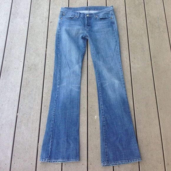 """7FAM boy cut button fly 33"""" inseam EXCELLENT used condition. NO FLAWS. Mid rise with a boot cut and button fly. Light weight stretchy denim. Very flattering fit! 7 for all Mankind Jeans Boot Cut"""