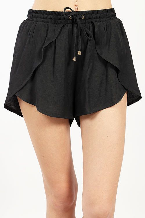 These black drawstring shorts feature unique flap detail in the front.  Summer…