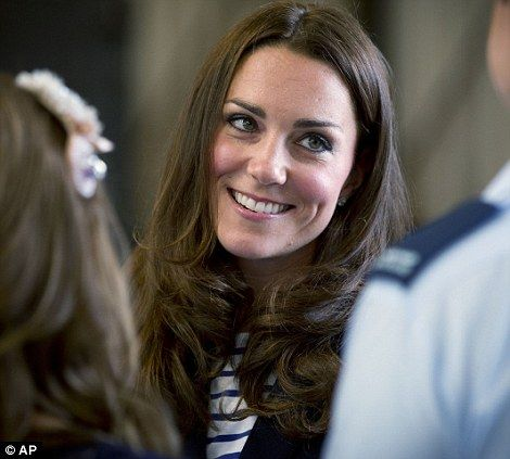 Good times: Kate looked to be enjoying the interaction with the Royal New Zealand Air Force families