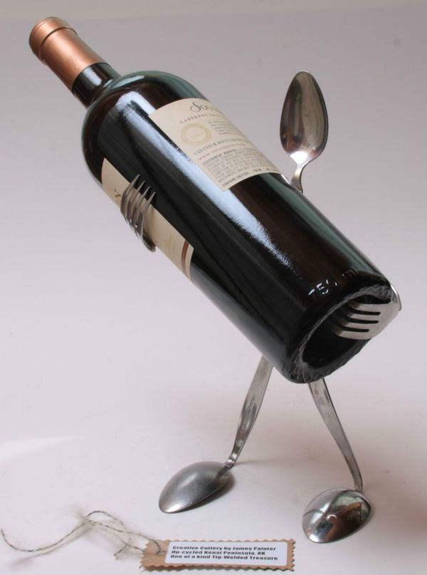 Cutlery wine steward *lol* - looks like a great idea for presentation of a bottle of wine.  Solder together 3 spoons & 2 forks. (via furnishburnish)