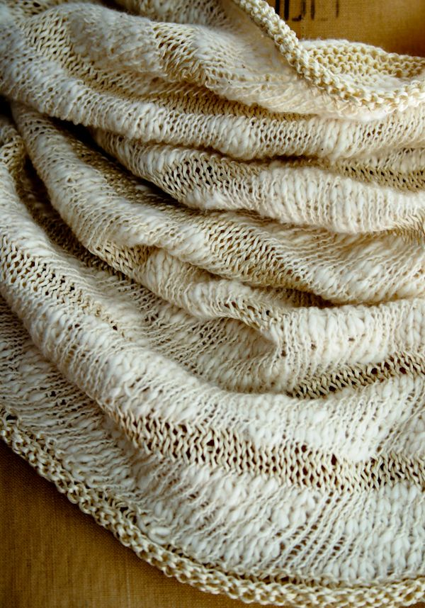 Elegant lightweight cowl. Free knitting pattern using fingering-weight yarn. Pattern attributes and techniques include: Seamless.