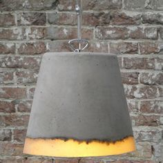 Netherlands-based industrial designer Renate Vos created a series of experimental pendant lamps using an unusual combination of concrete and silicone rubber.