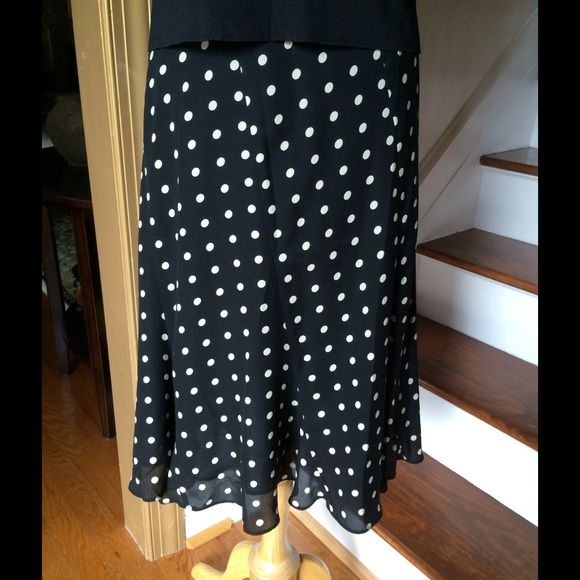 Jones New York Silk Polka Dot Skirt. NWOT Skirt features elasticized waistband with flirty ruffle bottom and takes beautifully to a classic polka dot print. • 100% Silk • Black Silk Lining • Dry Clean Jones New York Skirts