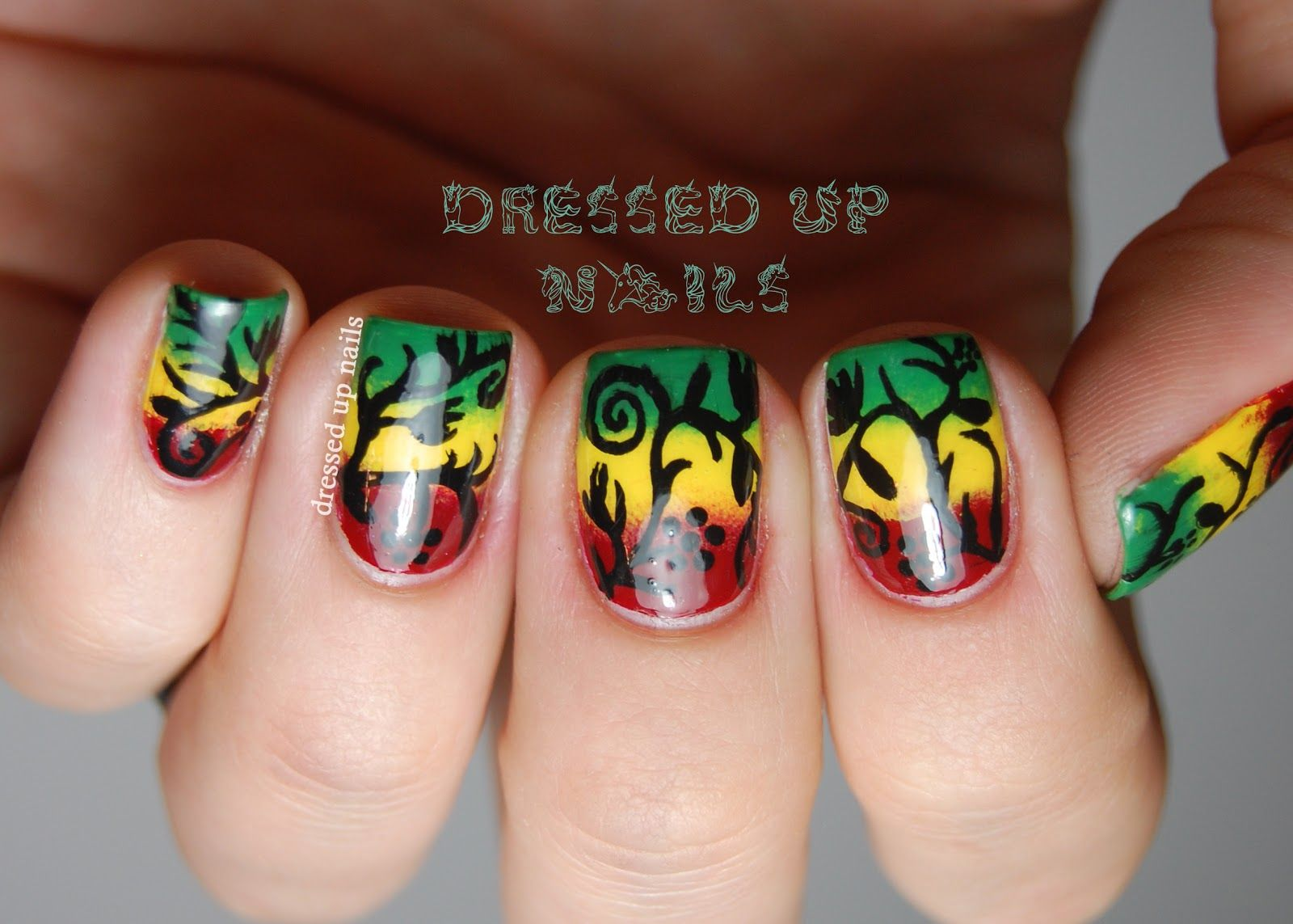 Dressed up nails freehand floral silhouette nail art over a dressed up nails freehand floral silhouette nail art over a rasta color gradient prinsesfo Choice Image