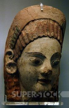 Etruscan painted antefix with shaped head of woman with earrings. 520-500 BC. From Cerveteri. British Museum. London. England. United Kingdom.
