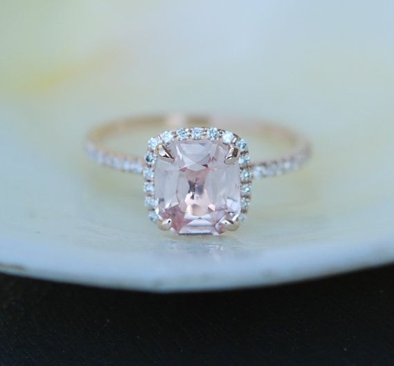 Engagement ring by Eidelprecious. Rose gold engagement ring with Peach sapphire. Peach Champagne Sapphire Engagement Ring. This ring features a