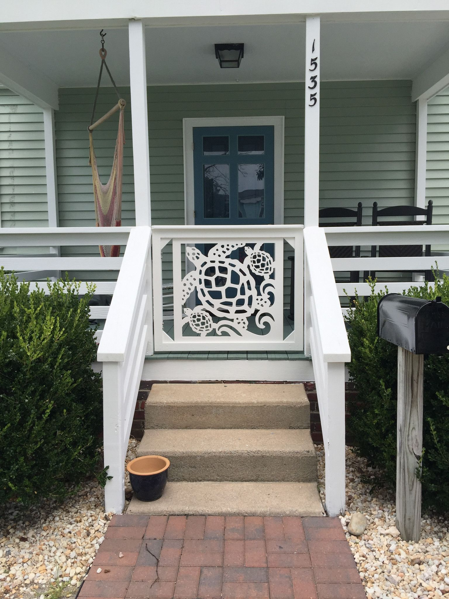 Our beautiful all weather pvc gate and porch railing for Beach porch ideas