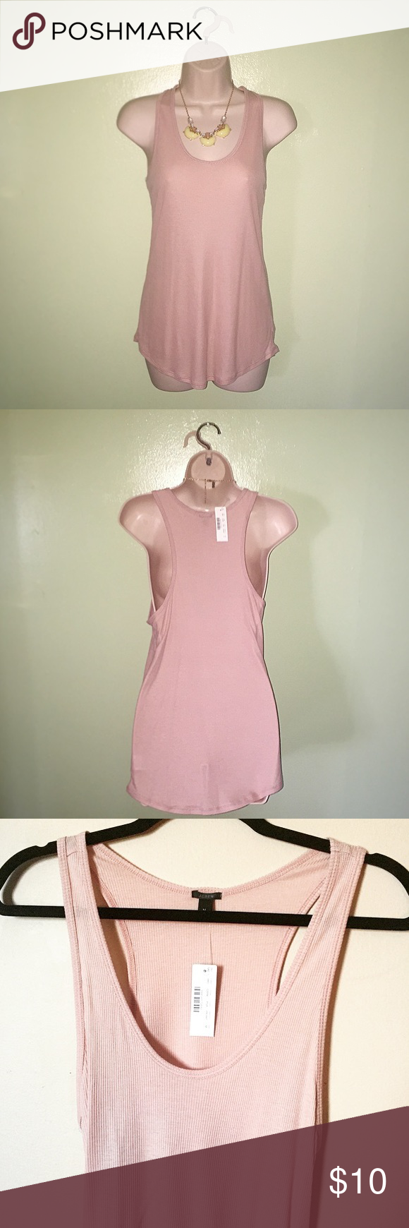 💕▶️🆕JCREW Ribbed Racerback Tank Top🆕◀️💕 New with tags JCREW ribbed racerback tank top, size medium. This top has a slightly loose, longer silhouette with slinky rubbed fabric and a racerback detail.   Features:  •Blush pink •Slightly loose fit •Body length: 26 1/4 inches •MSRP $29.50 J. Crew Tops Tank Tops