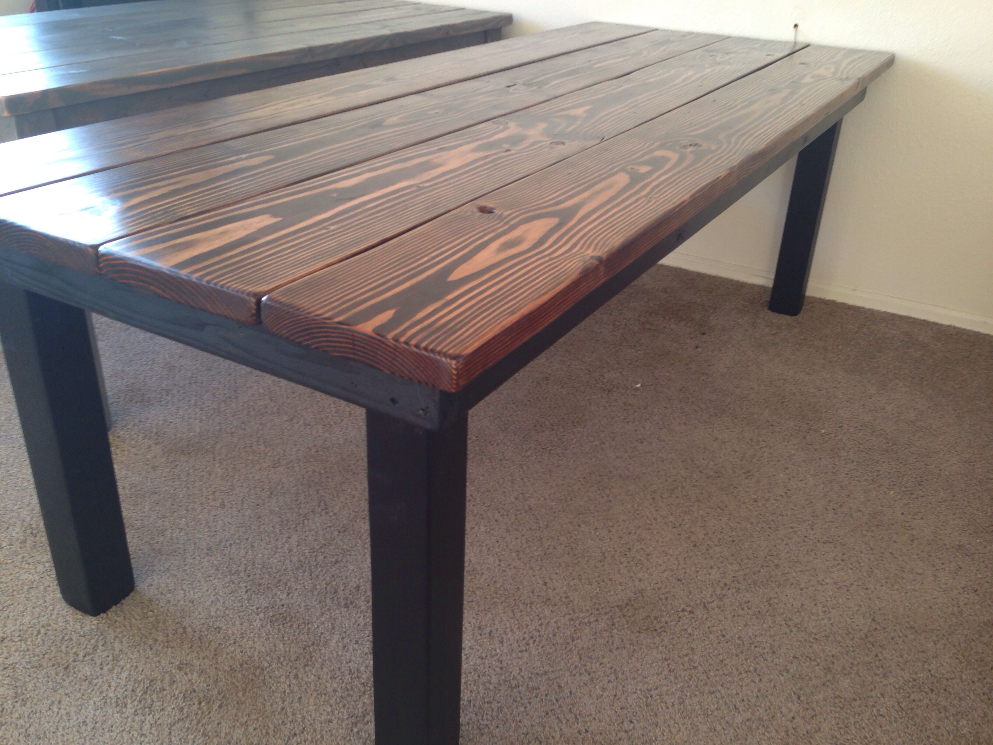 Custom planked top farmhouse table with dark walnut stain and black base Vis