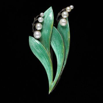 Lily of the Valley Brooch Made Of Enameled Silver Set With Pearls by Bernard Instone - Birmingham, England   c.1940-1950. From the online collections of the Victoria & Albert Museum.