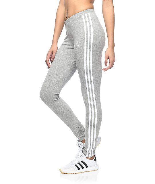 bf9fe294b68b3 Get your adidas style on point with these classic 3 Stripe grey leggings by  adidas. A super soft and stretchy cotton and spandex blend will allow you  to ...