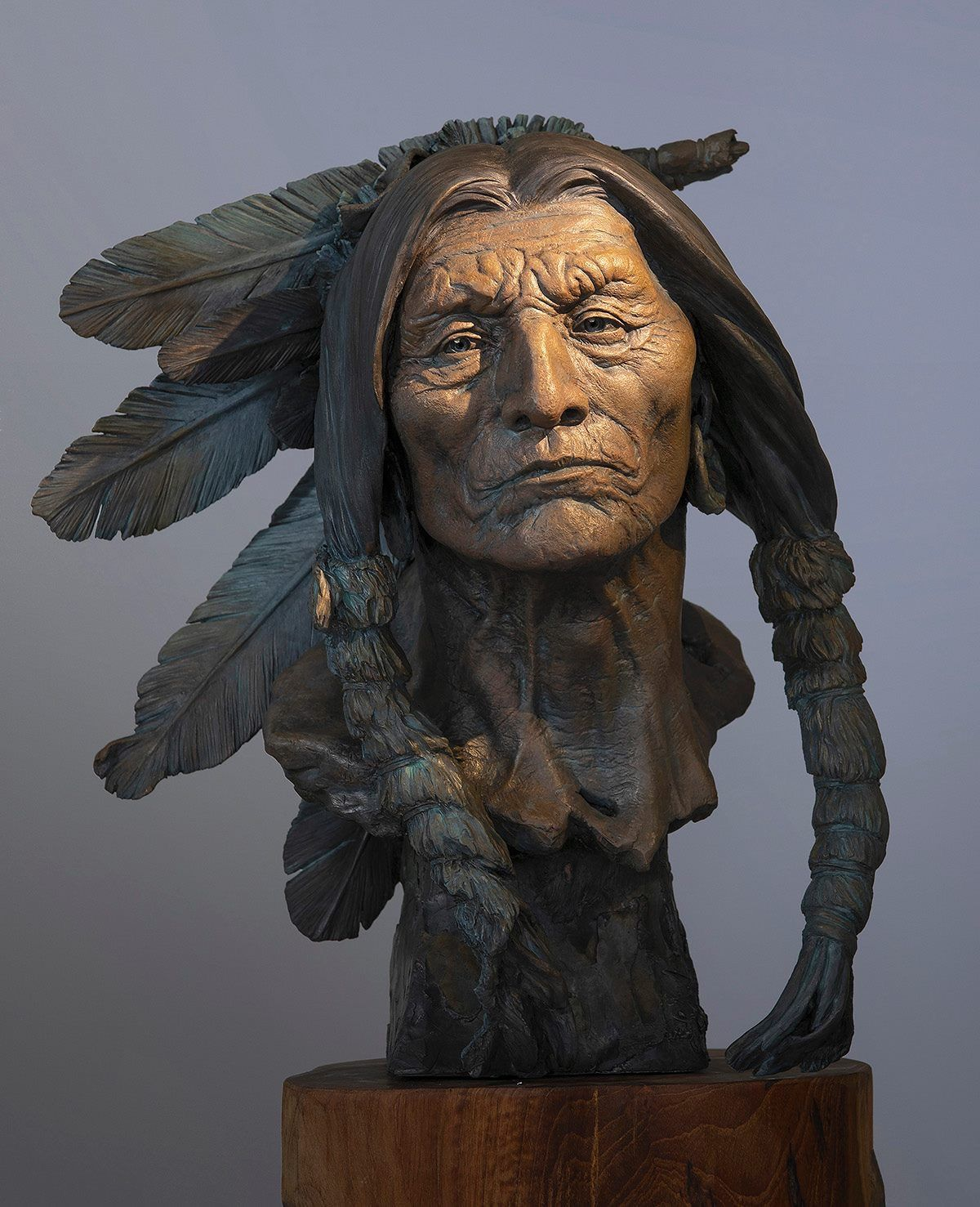A Sculpture Of A Native American Man From The Cheyenne