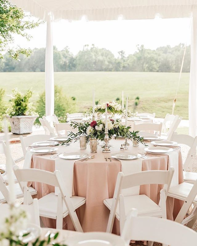 Summer Wedding Reception Tent Set For A Seated Dinner With Ivory And