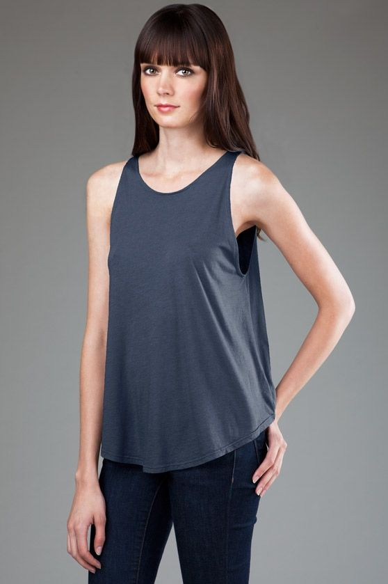BP - 4SMMJ229 - Side - Azul -- eco-HYBRID™ Micro Jersey High Neck Tank. The higher neckline on this tank is perfect for printing. Made in USA. • Sizes: S-L, 3.7 oz., Eco-Hybrid™ Micro Jersey. • Garment dyed and washed, preshrunk, heavenly soft, feather-light feel and fantastic drape. • Single-needle stitching at neck and armholes.