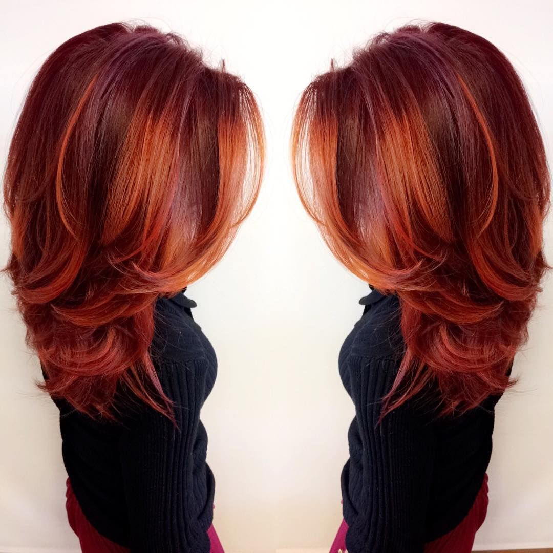 This vibrant firey red look was made with redken city beats color hair coloring urmus Choice Image