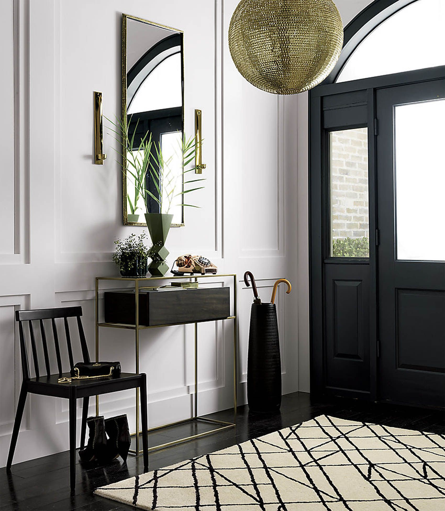 A bold entryway featuring furniture from cb2 victoria mcginley