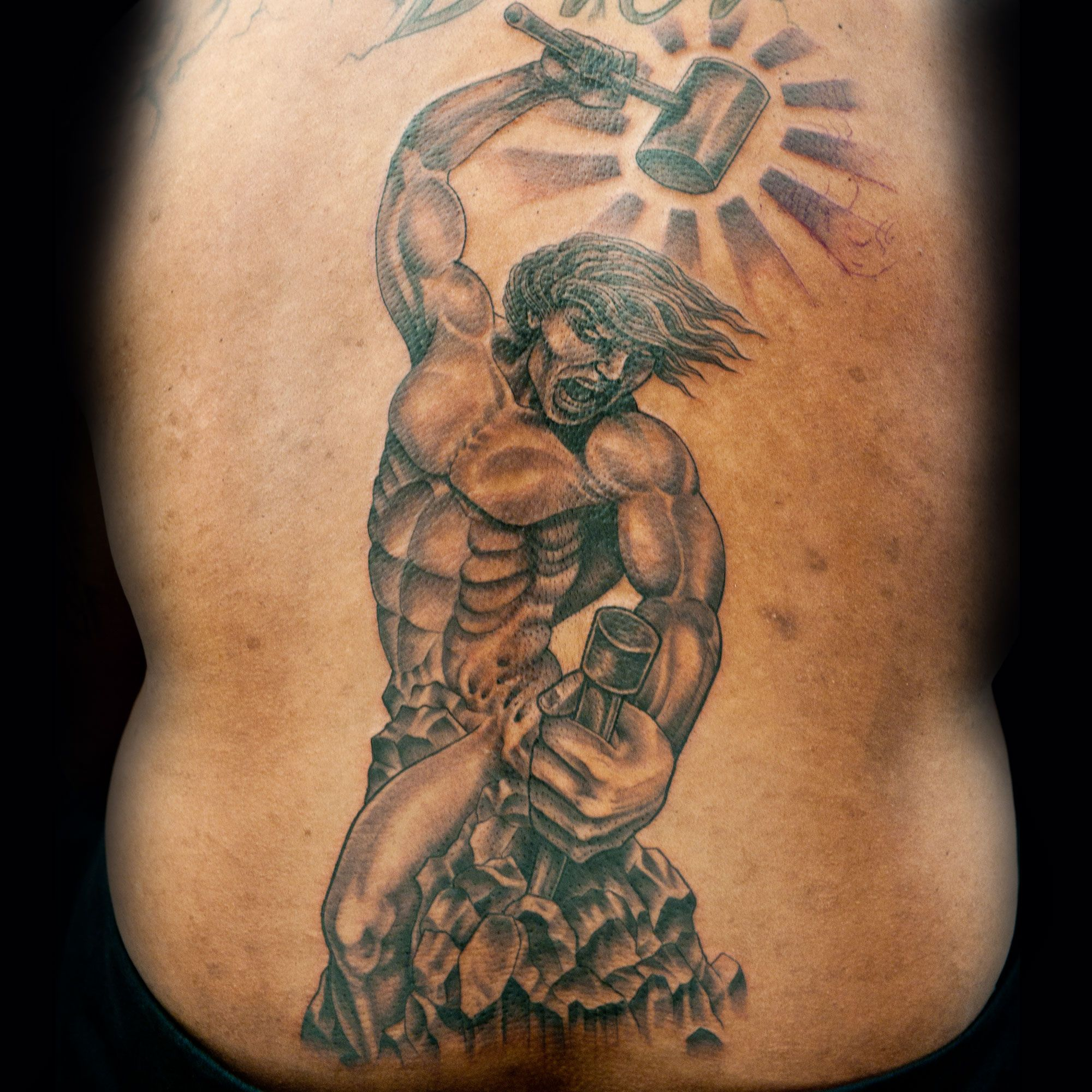 Check out this high res photo of Steve Tefft's tattoo from