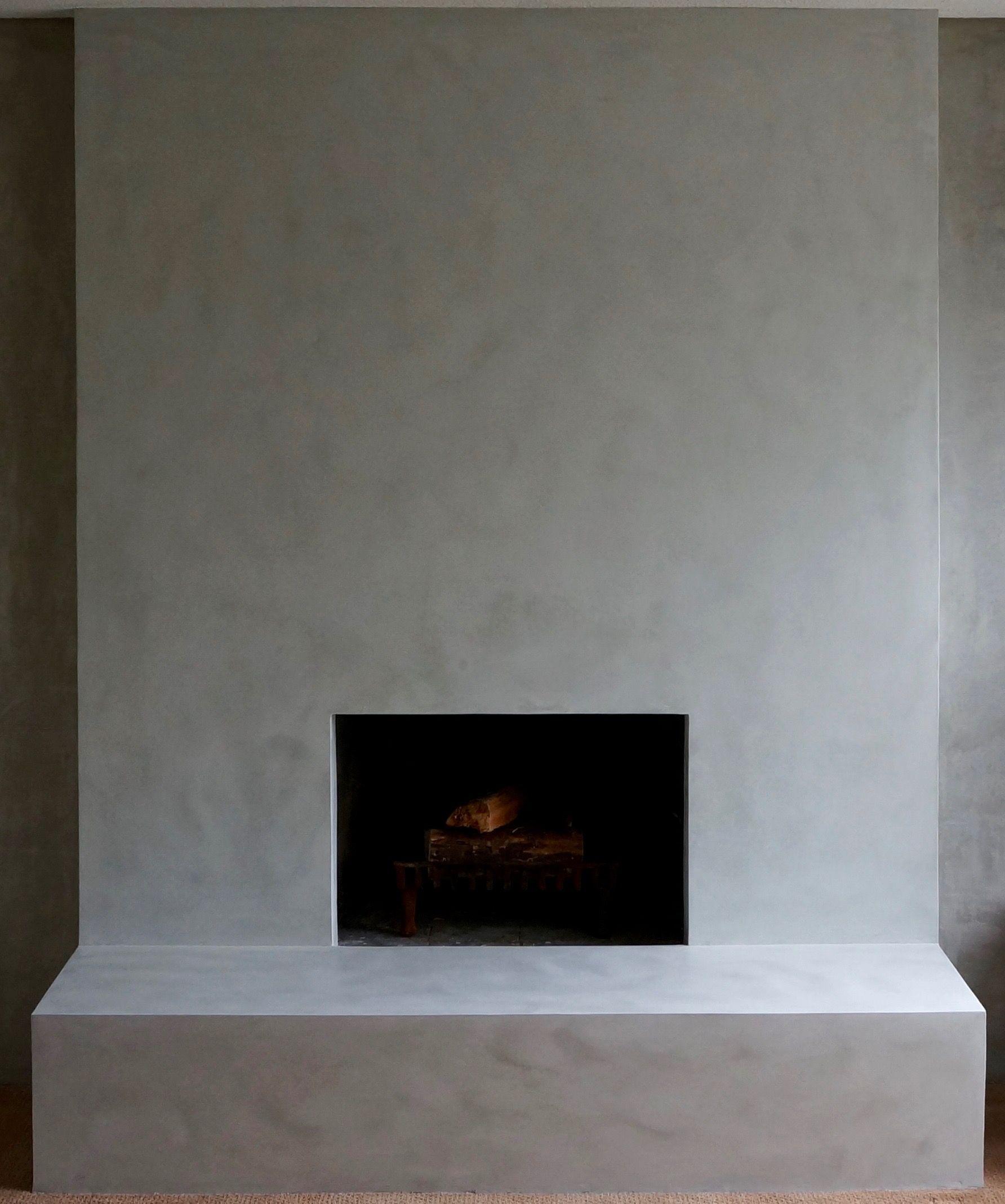 Polished lime plaster fireplace looks like limestone