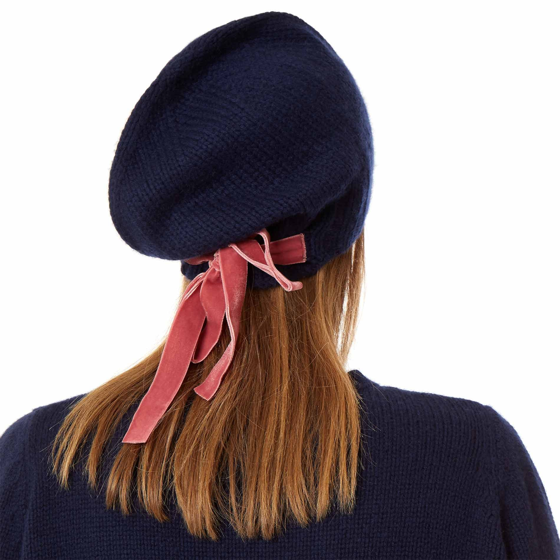 934de9c8d7b An oversized beanie made from super-soft cashmere and wool. Featuring  double-sided pink velvet ribbon ties for adding a charming bow to your hat.