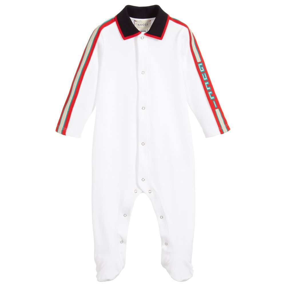 5d8f4f0e6a82 Baby boys white babygrow by luxury brand Gucci