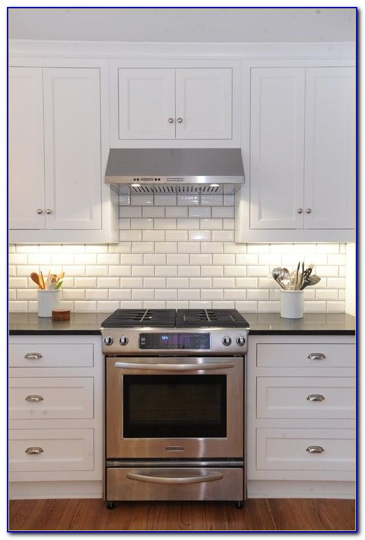 Beveled White Subway Tile With Gray Grout