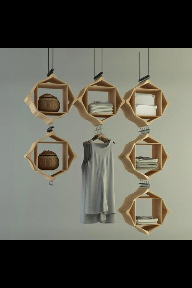 Prettiest substitute for a closet! That would look so cool and everything is visible, on display. It would force me to keep my clothing more organized as well