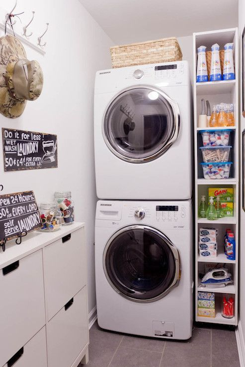 Perfectly Organized Laundry Room With Stacked Front Load Washer And