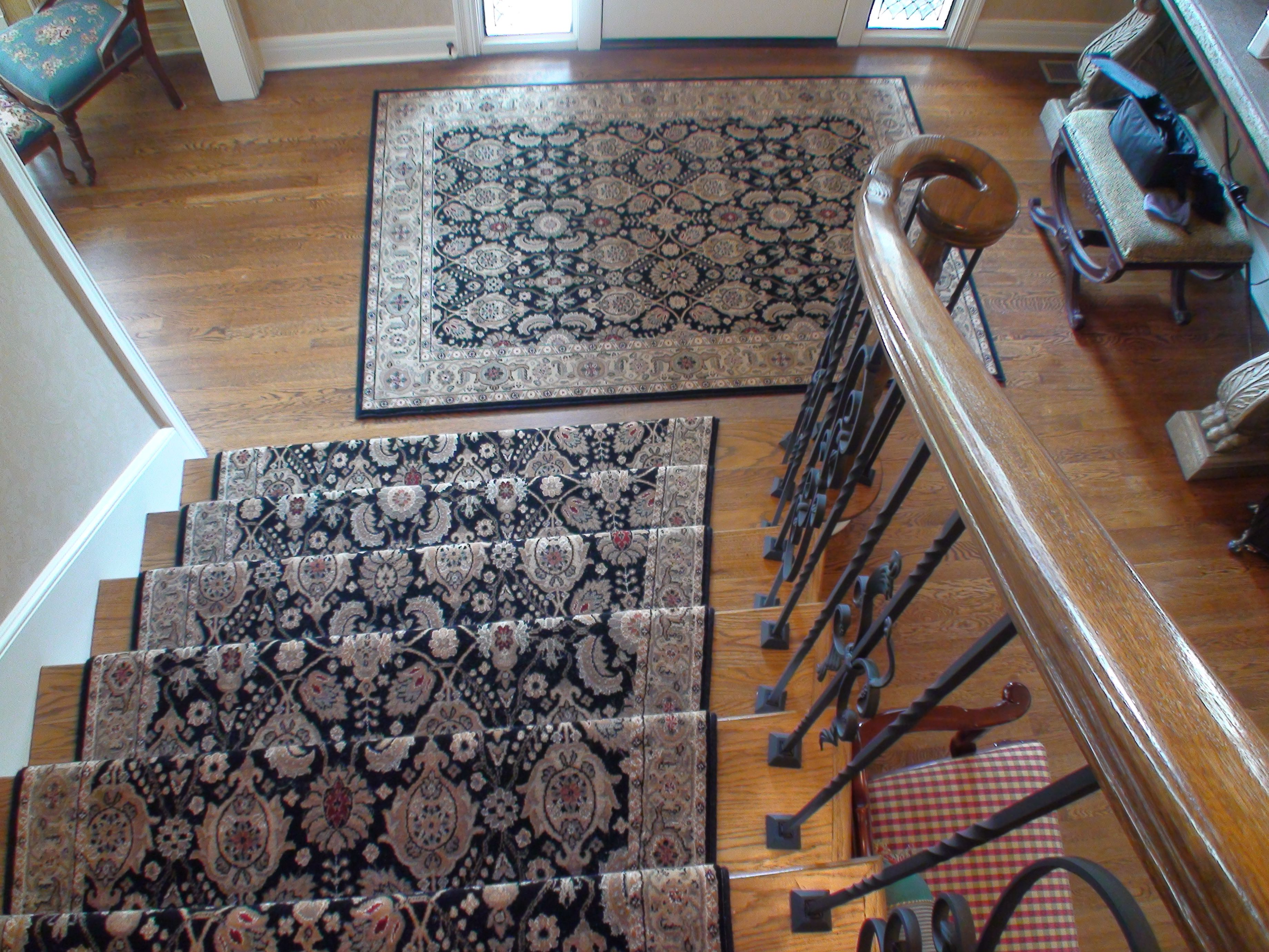 Custom sized matching staircase runners and front entry area rugs