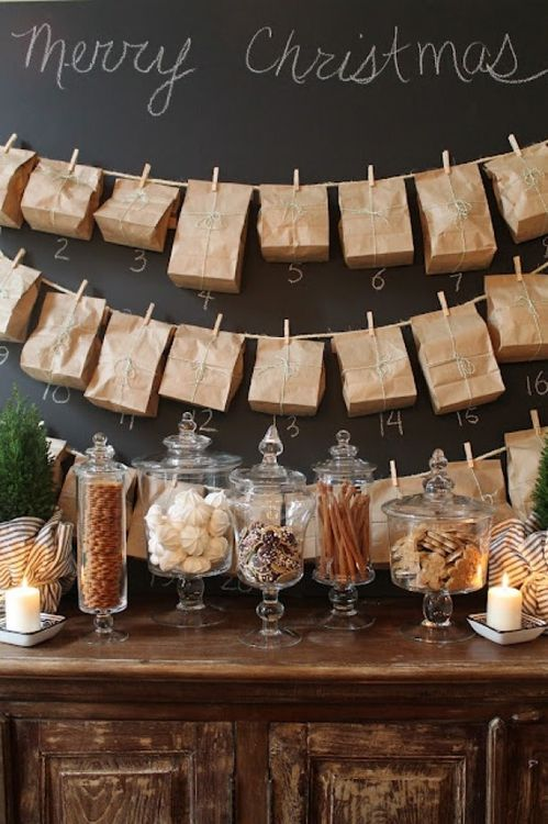 A chalk wall, advent calendars, and treats in pedestal jars.