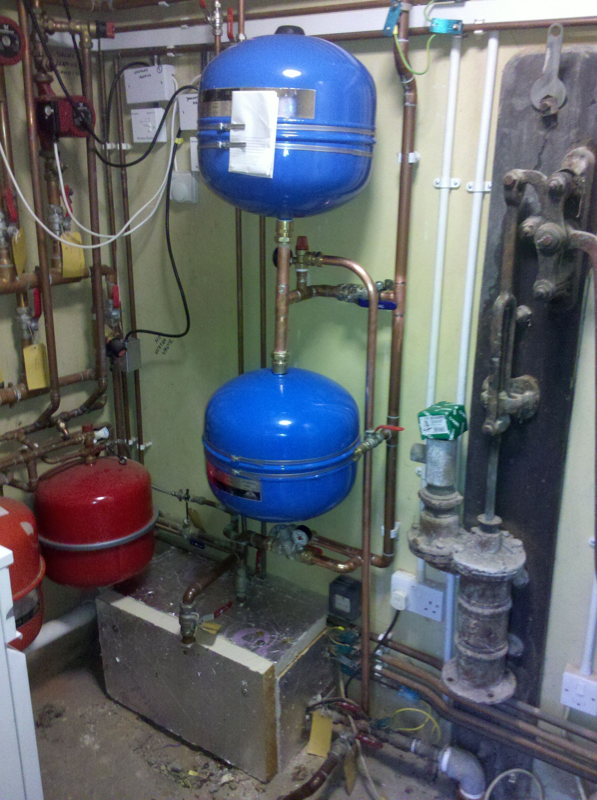 2 Pressure Vessels Regulating The Water Supply From A Bore Hole Pump Room With Plants Water Supply Bore Hole