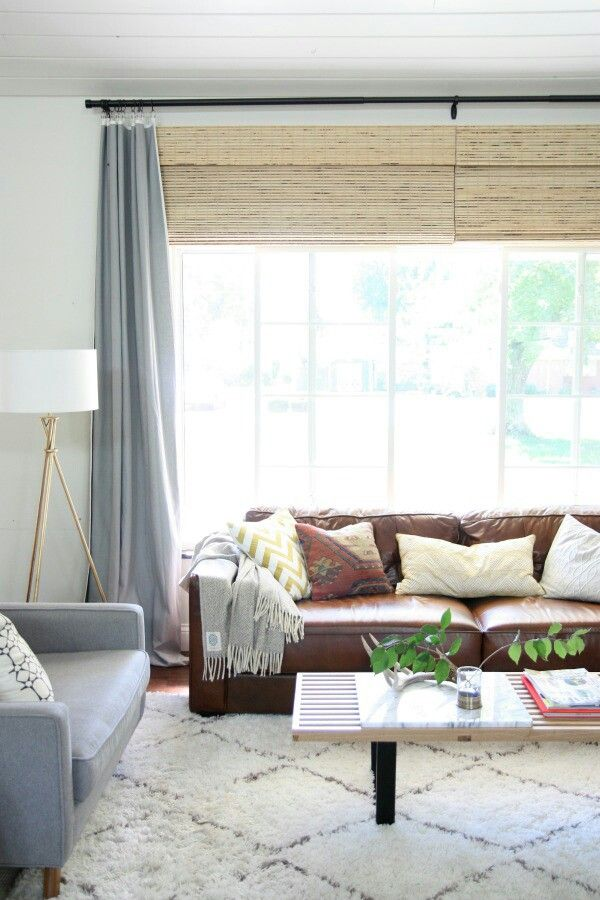 Brown leather couch decor looking at ways to lighten up a for Brown taupe living room