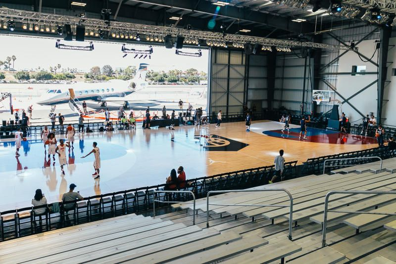 Inside Nike Basketball S Hangar In Los Angeles Outdoor Basketball Court Nike Basketball Stadium Architecture