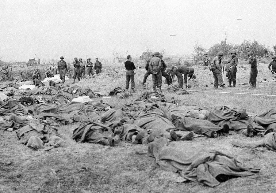 American dead lie in a French field, a short distance from the allied beachhead in France on June 20, 1944. #